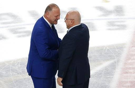 Vegas Golden Knights coach Gerard Gallant, left, shakes hands Washington Capitals coach Barry Trotz, right, after the Capitals defeated the Golden Knights 4-3 in Game 5 of the NHL hockey Stanley Cup Finals on Thursday, June 7, 2018, in Las Vegas.
