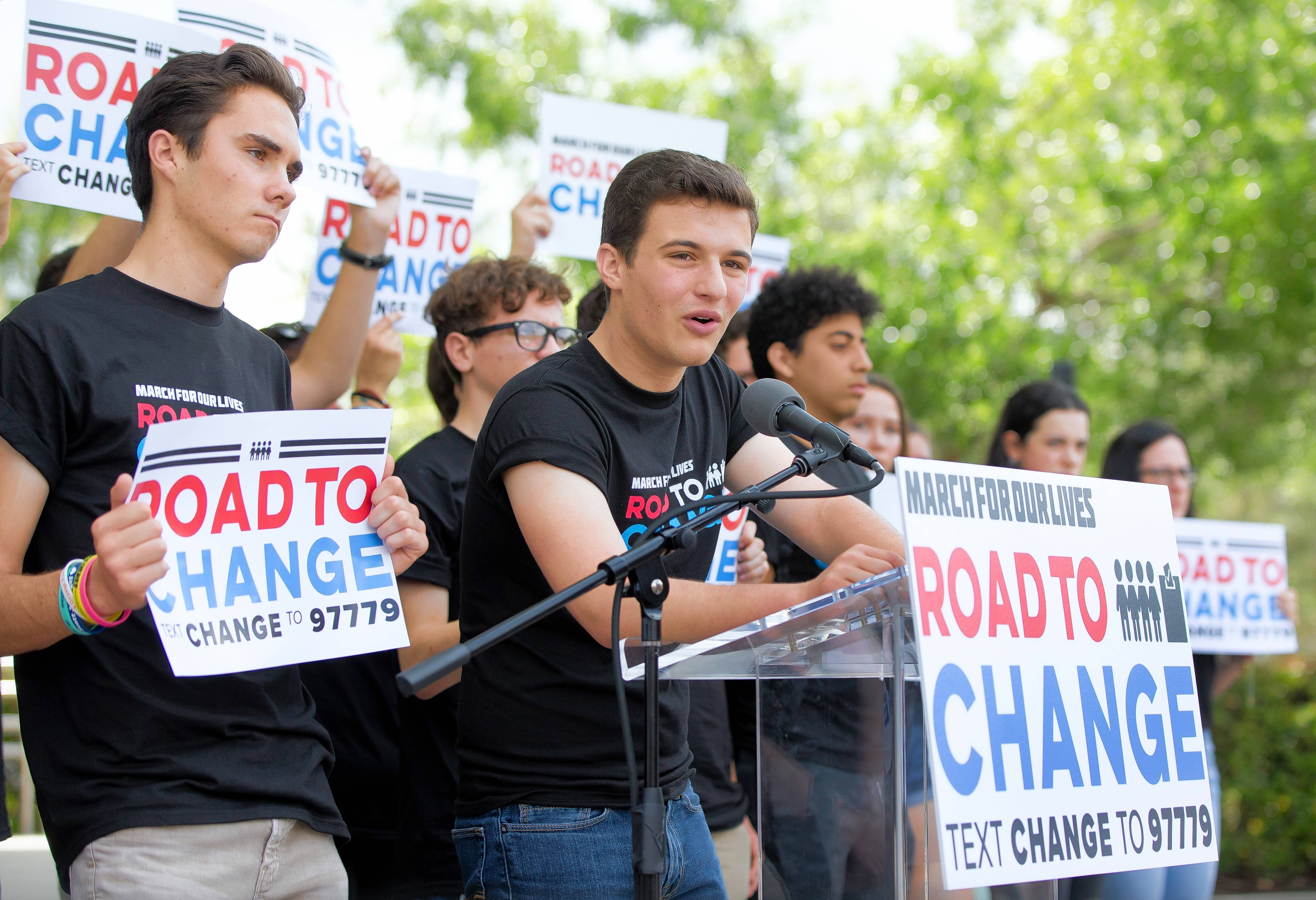 "Marjory Stoneman Douglas High School student Cameron Kasky, center, speaks during a news conference in Parkland, Fla., to announce the ""March For Our Lives: Road to Change"" tour, which will stop in Naperville on Saturday night."