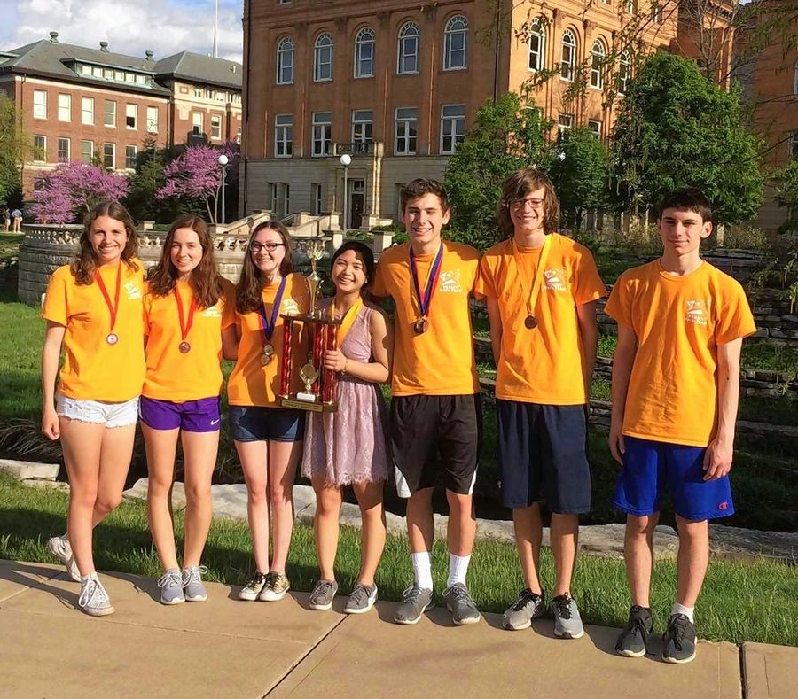 Clarissa Gomez, center, in dress, with the Hersey Math Team after the state contest in February at University of Illinois, Champaign. From left are Caroline Lubbe, Diana Spulber, Grace Huberty, Gomez, Luke Larson, Kevin Callahan and Charlie Saunders. Larson also achieved a perfect score on the ACT and SAT.