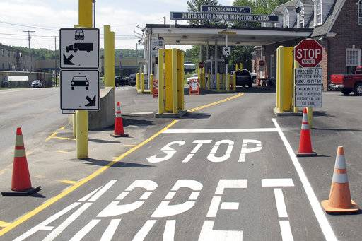 FILE - This Aug. 2, 2017 file photo shows the U.S. border crossing post at the Canadian border between Vermont and Quebec, Canada, at Beecher Falls, Vt. For the first time in decades, one of the world's most durable and amicable alliances faces serious strain as Canadians _ widely seen as some of the nicest, politest people on Earth _ absorb Donald Trump's insults against their prime minister and attacks on their country's trade policies.