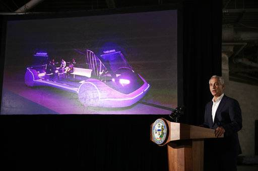 Mayor Rahm Emanuel speaks at a news conference Thursday, June 14, 2018, in Chicago. The Boring Company, founded by Tesla CEO Elon Musk, has been selected to build a high-speed underground transportation system that it says will whisk passengers from downtown Chicago to O'Hare International Airport in mere minutes.