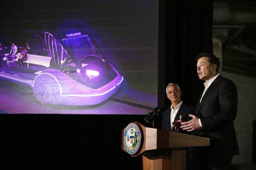 Chicago Mayor Rahm Emanuel, left, listens as Tesla CEO and founder of the Boring Company Elon Musk, right, speaks at a news conference Thursday, June 14, 2018, in Chicago. The Boring Company has been selected to build a high-speed underground transportation system that it says will whisk passengers from downtown Chicago to O'Hare International Airport in mere minutes.