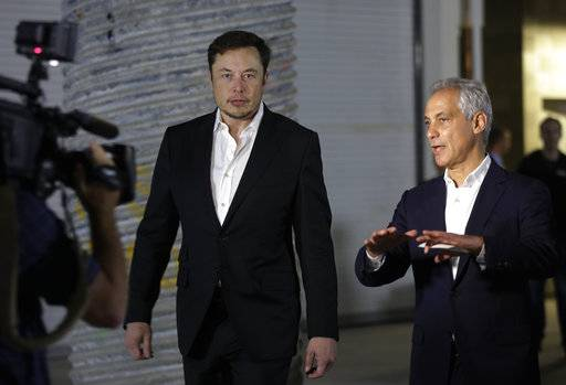 Tesla CEO and founder of the Boring Company Elon Musk, left, and Chicago Mayor Rahm Emanuel arrive at a news conference, Thursday, June 14, 2018, in Chicago. The Boring Company has been selected to build a high-speed underground transportation system that it says will whisk passengers from downtown Chicago to O'Hare International Airport in mere minutes.