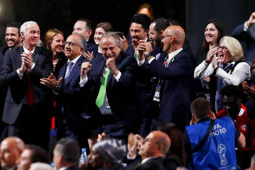 Delegates of Canada, Mexico and the United States celebrate after winning a joint bid to host the 2026 World Cup at the FIFA congress in Moscow, Russia, Wednesday, June 13, 2018. Standing on front row from left: Steve Reed, president of the Canadian Soccer Association, Carlos Cordeiro, U.S. soccer president and Decio de Maria, President of the Football Association of Mexico.