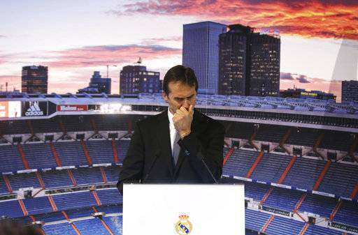 Newly appointed Real Madrid coach Julen Lopetegui gestures, during a press conference in Madrid, Thursday, June 14, 2018. Lopetegui was the Spanish National team's coach but was fired on Wednesday, two days before Spain's opening match against Portugal, because he had accepted the job to coach Real Madrid next season.
