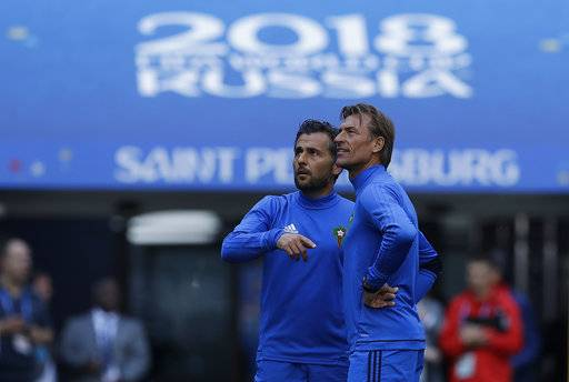 Morocco coach Herve Renard, right, with team official during the official training of Morocco on the eve of the group B match between Morocco and Iran at the 2018 soccer World Cup in the St. Petersburg Stadium in St. Petersburg, Russia, Thursday, June 14, 2018.