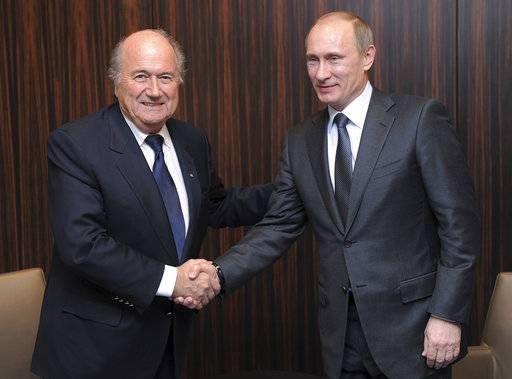 FILE - In this Thursday, Dec. 2, 2010 file photo, Russian Prime Minister Vladimir Putin, right, shakes hands with FIFA President Joseph Blatter after Russia was announced as the host for the 2018 soccer World Cup in Zurich, Switzerland. Vladimir Putin was only the prime minister of Russia, not president, when it won a 2018 World Cup hosting campaign that is still under criminal investigation. It was still clearly his victory in a campaign that got stronger through 2010 as Putin became more involved.