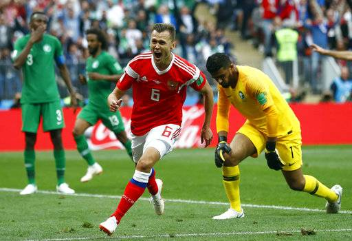 Russia's Denis Cheryshev celebrates after scoring his side's second goal during the group A match between Russia and Saudi Arabia which opens the 2018 soccer World Cup at the Luzhniki stadium in Moscow, Russia, Thursday, June 14, 2018.