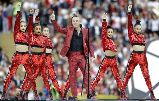 British singer Robbie Williams performs before the group A match between Russia and Saudi Arabia which opens the 2018 soccer World Cup at the Luzhniki stadium in Moscow, Russia, Thursday, June 14, 2018.