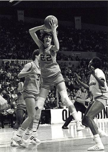 FILE - In this file photo, date not known, Old Dominion's Anne Donovan grabs the ball during a basketball game. Donovan, the Basketball Hall of Famer who won a national championship at Old Dominion, two Olympic gold medals in the 1980s and coached the U.S. to gold in 2008, died Wednesday, June 13, 2018, of heart failure. She was 56. Donovan's family confirmed the death in a statement. (The Virginian-Pilot via AP, File)