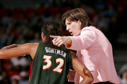 FILE - In this June 15, 2006, file photo, Seattle Storm coach Anne Donovan, right, talks to Shaunzinski Gortman during the fourth quarter of the team's WNBA basketball game against the Chicago Sky in Chicago. The Storm won 74-61. Donovan, the Basketball Hall of Famer who won a national championship at Old Dominion, two Olympic gold medals in the 1980s and coached the U.S. to gold in 2008, died Wednesday, June 13, 2018, of heart failure. She was 56. Donovan's family confirmed the death in a statement.