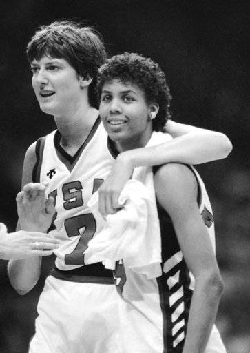 FILE - In this August 1984 file photo, United States' Anne Donovan, left, and Cheryl Miller celebrating the team's victory over Canada in women's basketball at the Olympics in Los Angeles. Donovan, the Basketball Hall of Famer who won a national championship at Old Dominion, two Olympic gold medals in the 1980s and coached the U.S. to gold in 2008, died Wednesday, June 13, 2018, of heart failure. She was 56. Donovan's family confirmed the death in a statement.