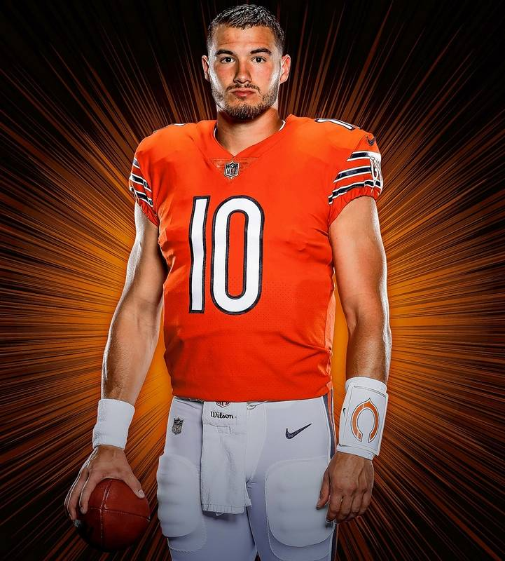 Photo courtesy of Chicago Bears. Quarterback Mitch Trubisky models the  team s orange jersey for this season. 92543cbe4