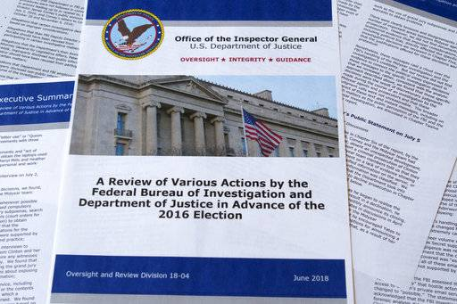 Part of the the Department of Justice Inspector General's report after its release in Washington, Thursday, June 14, 2018. The report documented in painstaking detail one of the most consequential investigations in modern FBI history and revealed how the bureau, which for decades has endeavored to stand apart from politics, came to be entangled in the 2016 presidential election.
