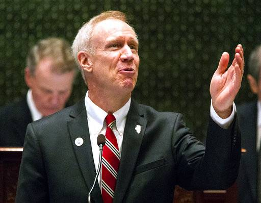 FILE - In this Jan. 31, 2018 file photo, Illinois Gov. Bruce Rauner delivers his State of the State  address at the Capitol, in Springfield, Ill. Legislation aimed at curbing gun violence, some of which wouldn't have stood a chance just a few years ago, won approval in the Illinois General Assembly this spring amid scrambling to answer what seem to be ever-increasing instances of mass shootings. Ultimately, they're bound for Gov. Bruce Rauner, who's proposed his own measures, in some cases similar to those OK'd by Democrats who control the Legislature. (Rich Saal/The State Journal-Register via AP File)/The State Journal-Register via AP)