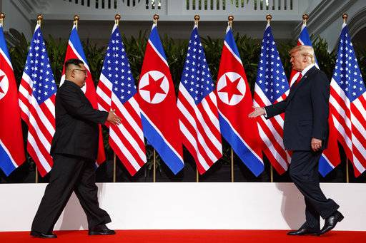 In this June 12, 2018, photo, President Donald Trump meets with North Korean leader Kim Jong Un on Sentosa Island in Singapore. Trump credits his accord with North Korea's Kim Jong Un with saving tens of millions from nuclear war. Now he just has to get everyone else on board. Frustrated with lukewarm backing from congressional Republicans, criticism from Democratic opponents, and skepticism from allies and the media, President Donald Trump made an extraordinary stop on the North Lawn of the White House Friday to promote the nuclear deal that critics have decried as a vague and lacking in clear objectives. (AP Photo/Evan Vucci)