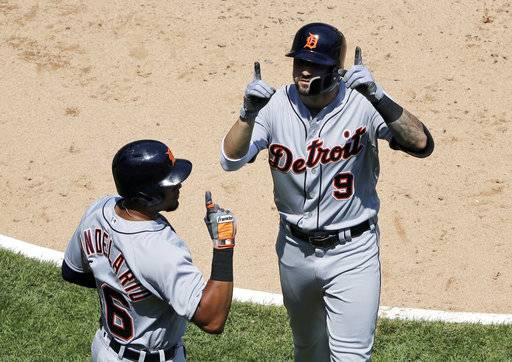 Detroit Tigers' Nick Castellanos, right, celebrates with Jeimer Candelario after hitting a two-run home run during the fifth inning of a baseball game against the Chicago White Sox in Chicago, Saturday, June 16, 2018.
