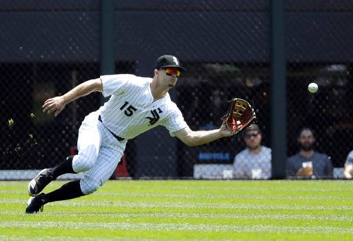 Chicago White Sox center fielder Adam Engel makes a catch on Detroit Tigers' Leonys Martin during the first inning of a baseball game in Chicago, Saturday, June 16, 2018.