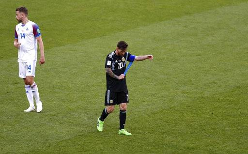Argentina s Lionel Messi walks from the field following their group D match  against Iceland at the 3a4165889037d