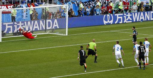 Iceland goalkeeper Hannes Halldorsson saves a penalty attempt by Argentina s  Lionel Messi during the group D e9db6d02b526c