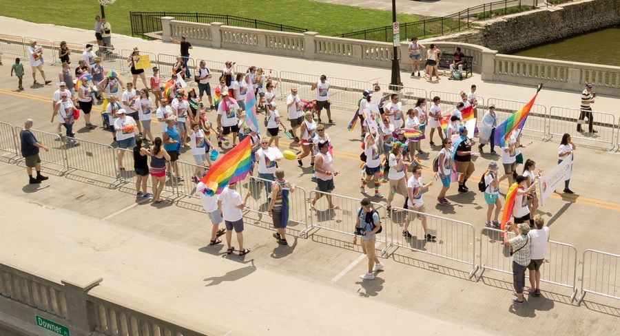 Participants from Youth Outlook march Sunday in the Aurora Pride Parade. Thousands marched in the parade or lined city streets to watch entries pass by in what was a first-of-its-kind event in the Western suburbs.
