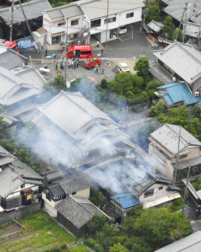 Smoke rises from a house blaze in Takatsuki, Osaka, following an earthquake Monday, June 18, 2018.  A strong earthquake has shaken the city of Osaka in western Japan. There are reports of scattered damage including broken glass and concrete. (Yohei Nishimura/Kyodo News via AP)