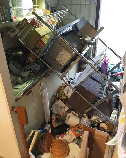 Scattered objects lie in the kitchen of a damaged house in Osaka, following an earthquake Monday, June 18, 2018.  A strong earthquake has shaken the city of Osaka in western Japan. There are reports of scattered damage including broken glass and concrete. (Kyodo News via AP)
