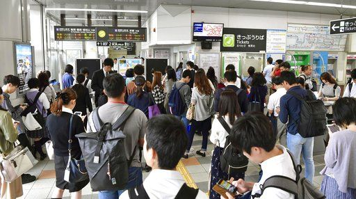 People wait for the resumption of train service which was suspended following an earthquake, at Nijo station, Kyoto, western Japan, Monday, June 18, 2018.  A strong earthquake has shaken the city of Osaka in western Japan. There are reports of scattered damage including broken glass and concrete. (Ren Onuma/Kyodo News via AP)