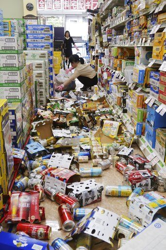 Cans and other items litter the floor of a convenience store, following an earthquake in Hirakata, Osaka, Monday, June 18, 2018. A strong earthquake knocked over walls and set off scattered fires around the city of Osaka in western Japan on Monday morning.(Ikuo Tatsumi/Kyodo News via AP)