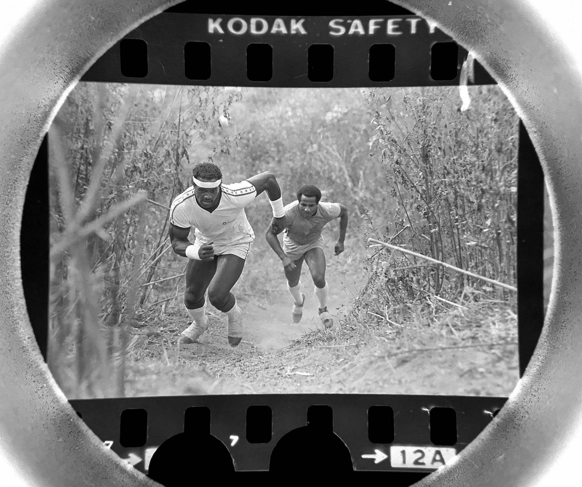 "The Daily Herald archive, Assignment # 64,686, Rosemary Kaul photo: Chicago Bears running back Walter Payton and Dennis Gentry train on ""the hill"" in Arlington Heights in October of 1982. Payton routinely trained on the hill which is now part of Nickol Knoll Golf Course."