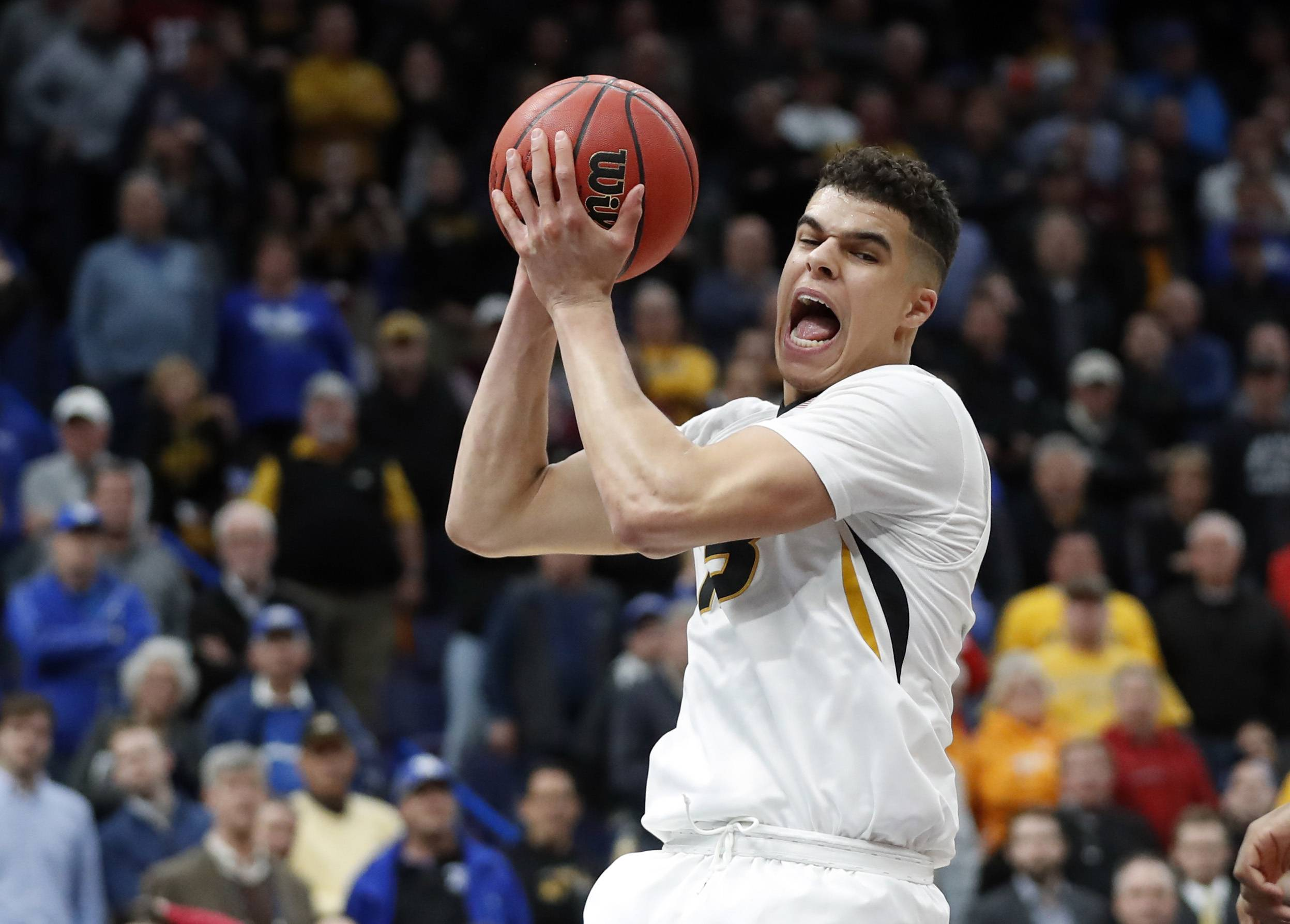 FILE - In this March 8, 2018, file photo, Missouri's Michael Porter Jr. pulls down a rebound during the second half in an NCAA college basketball game against Georgia at the Southeastern Conference tournament, in St. Louis. Michael Porter Jr. played in three games in college because of back problems, but his talent has long been considered more than NBA-ready. He is the epitome of high-risk, high-reward in this draft. (AP Photo/Jeff Roberson, File)
