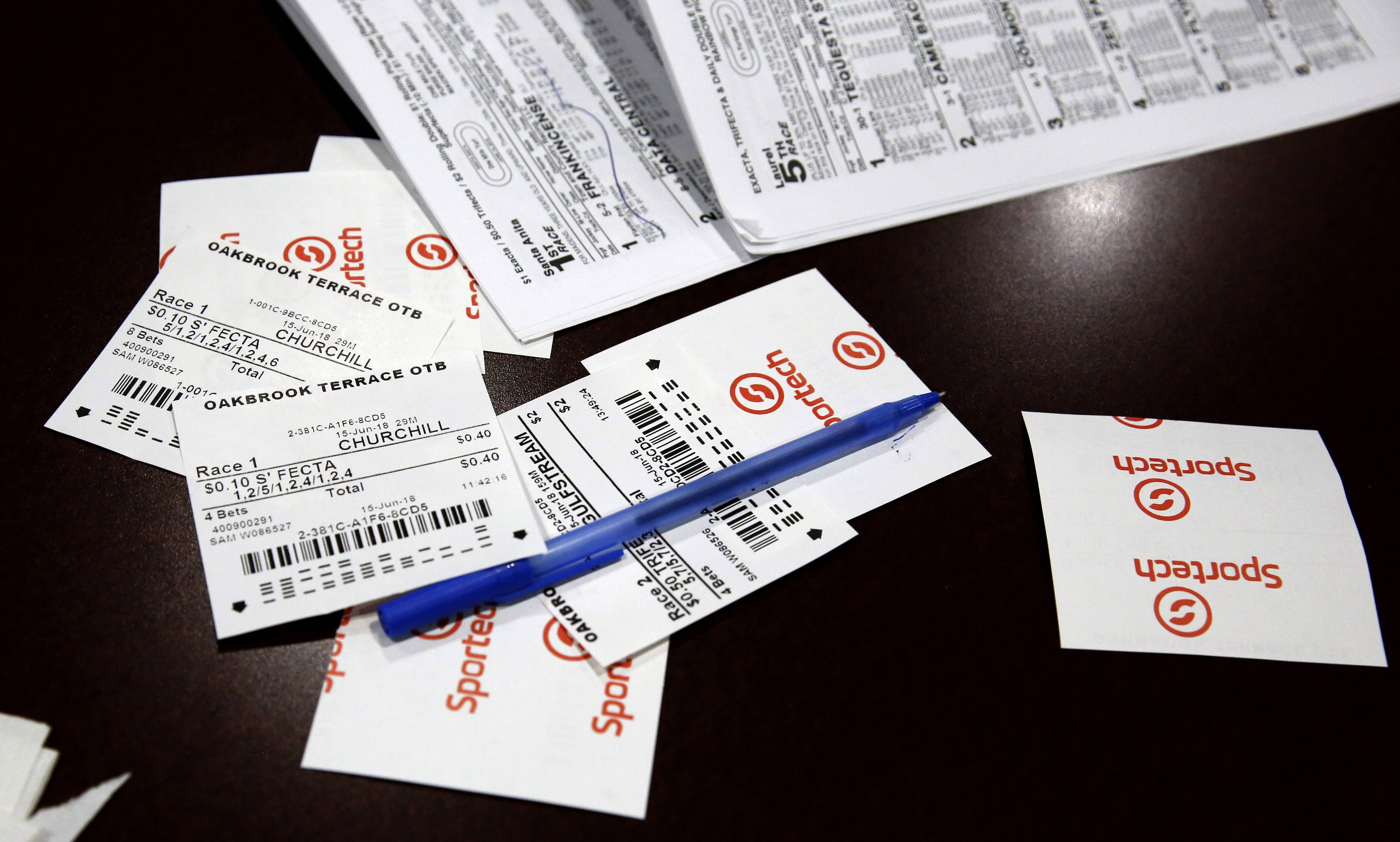 Losing betting slips at an Oakbrook Terrace off-track betting facility.