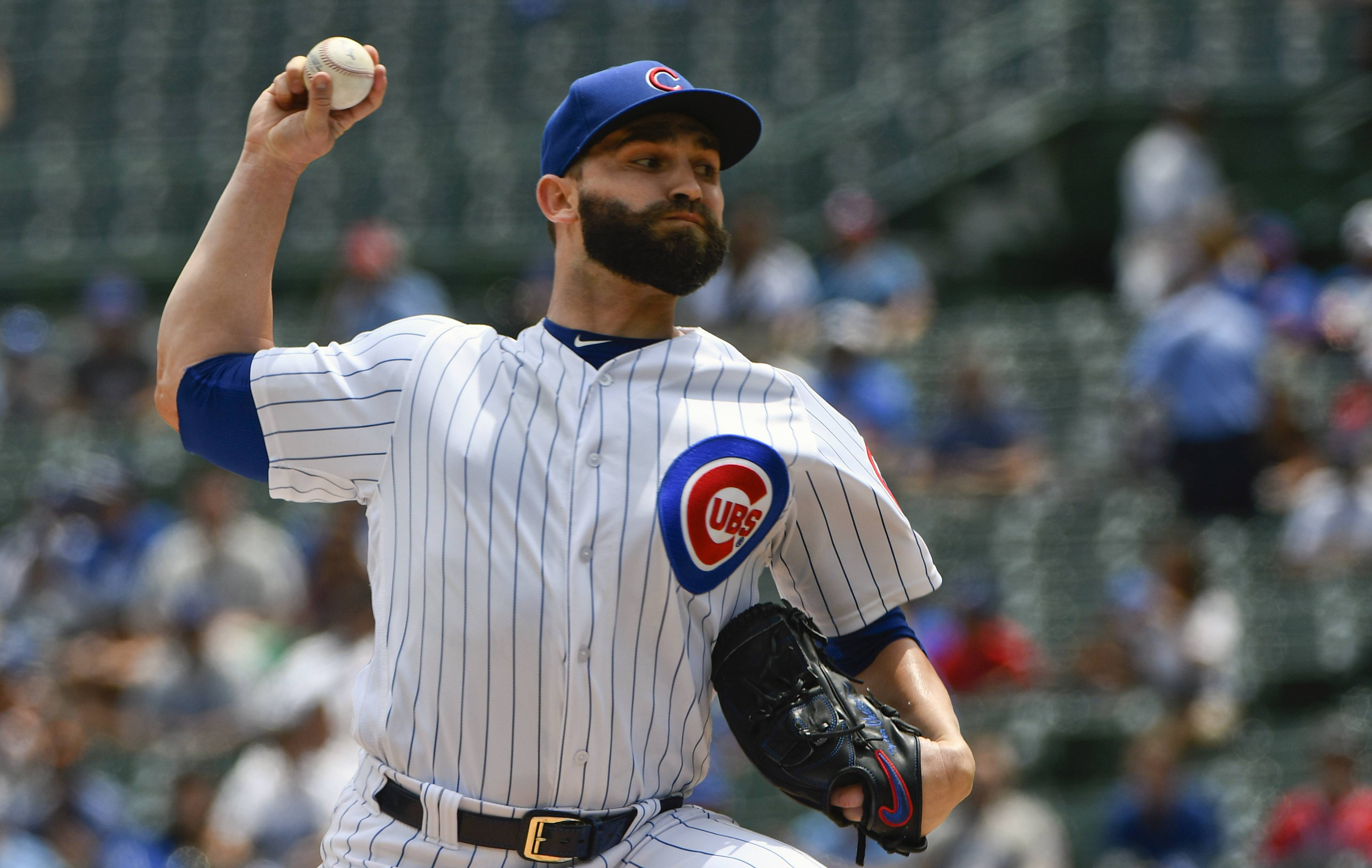 Chicago Cubs starting pitcher Tyler Chatwood (21) delivers during the first inning of a baseball game against the Los Angeles Dodgers on Tuesday, June 19, 2018, in Chicago. (AP Photo/Matt Marton)