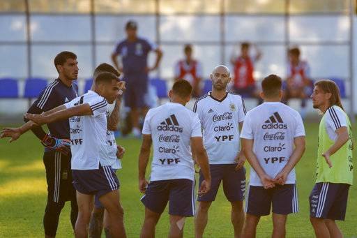 Javier Mascherano, third from left, chats with teammates during a training session of Argentina at the 2018 soccer World Cup in Bronnitsy, Russia, Monday, June 18, 2018.
