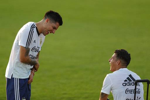 Enzo Perez, left, and Cristian Pavon joke during a training session of Argentina at the 2018 soccer World Cup in Bronnitsy, Russia, Monday, June 18, 2018.