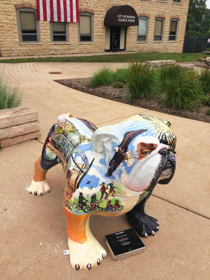 "One of the 30 fiberglass statues in the ""Bulldogs Unleashed"" exhibit. This one, sponsored by the city of Batavia, is near the Batavia Government Center. The statues will be sold in September to raise money for foundations that aid the school, library and park districts."