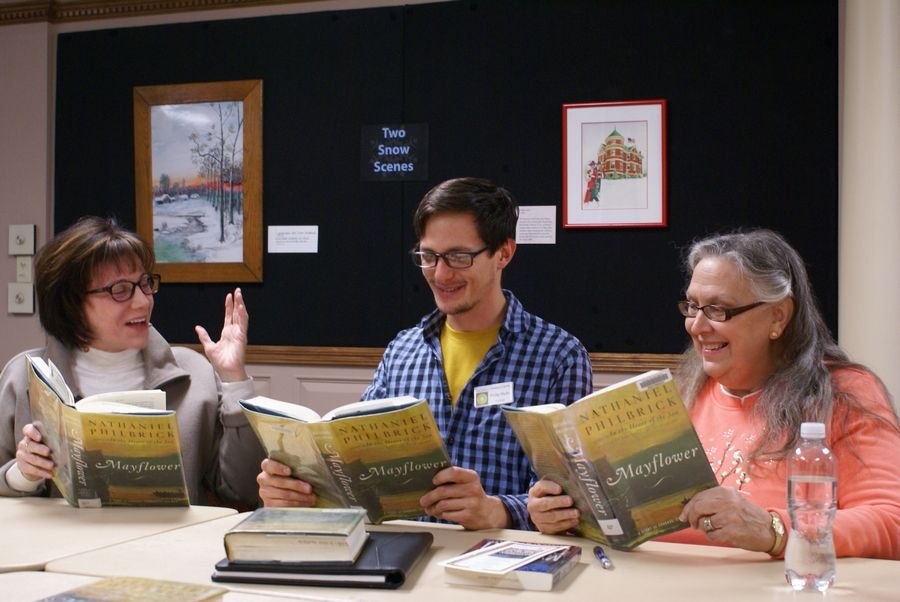 Newly-appointed Executive Director Philip Mohr, center, leads a Des Plaines History Center Book Club discussion with attendees Kathy Vana, left, and Mariann Mannarelli.