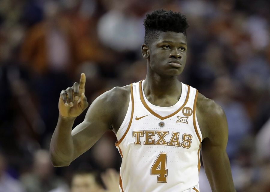 FILE - In this Feb. 7, 2018, file photo, Texas forward Mohamed Bamba (4) gestures during the second half of an NCAA college basketball game against Kansas State, in Austin, Texas. Kansas won 67-64. Bamba is expected to be taken in Thursday's NBA Draft.