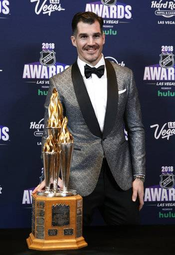 New Jersey Devils' Brian Boyle poses with the Bill Masterton Memorial Trophy after winning the honor at the NHL Awards, Wednesday, June 20, 2018, in Las Vegas.