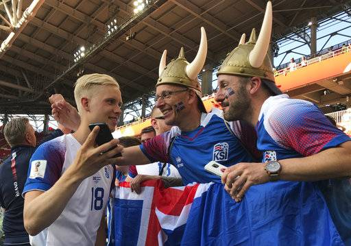 Iceland's Hordur Magnusson talks to fans after the group D match between Argentina and Iceland at the 2018 soccer World Cup in the Spartak Stadium in Moscow, Russia, Wednesday, June 13, 2018.