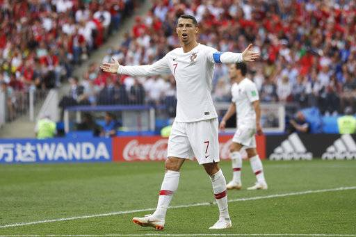 Portugal's Cristiano Ronaldo, center, reacts during the group B match between Portugal and Morocco at the 2018 soccer World Cup in the Luzhniki Stadium in Moscow, Russia, Wednesday, June 20, 2018.