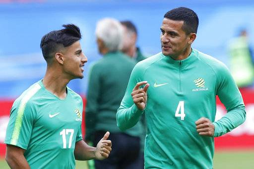 Australia's Tim Cahill, right, and Daniel Arzani talk during Australia's official training for the group C match between France and Australia at the 2018 soccer World Cup in the Kazan Arena in Kazan, Russia, Friday, June 15, 2018.