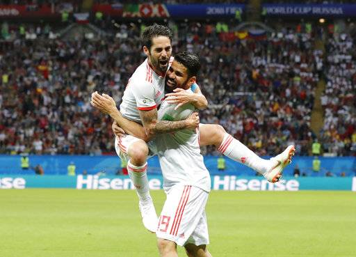 Spain's Diego Costa, right, celebrates with Spain's Isco his side's first goal during the group B match between Iran and Spain at the 2018 soccer World Cup in the Kazan Arena in Kazan, Russia, Wednesday, June 20, 2018.