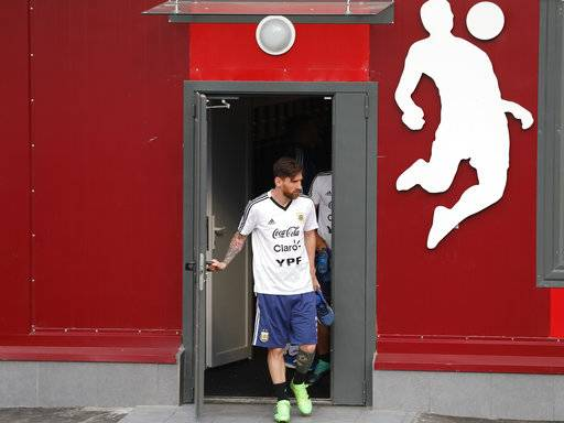 Lionel Messi arrives for a training session of Argentina at the 2018 soccer World Cup in Bronnitsy, Russia, Tuesday, June 19, 2018.