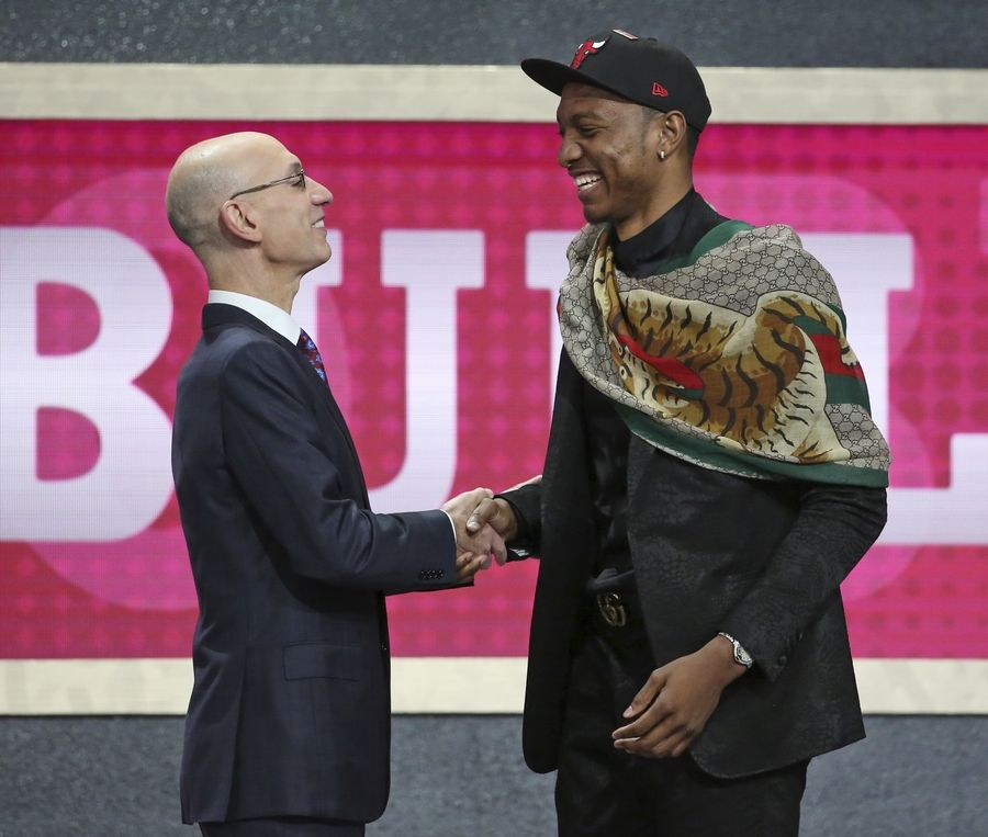 Duke's Wendell Carter Jr., right, shakes hands with NBA Commissioner Adam Silver after he was picked seventh overall by the Chicago Bulls during the NBA basketball draft in New York, Thursday, June 21, 2018.