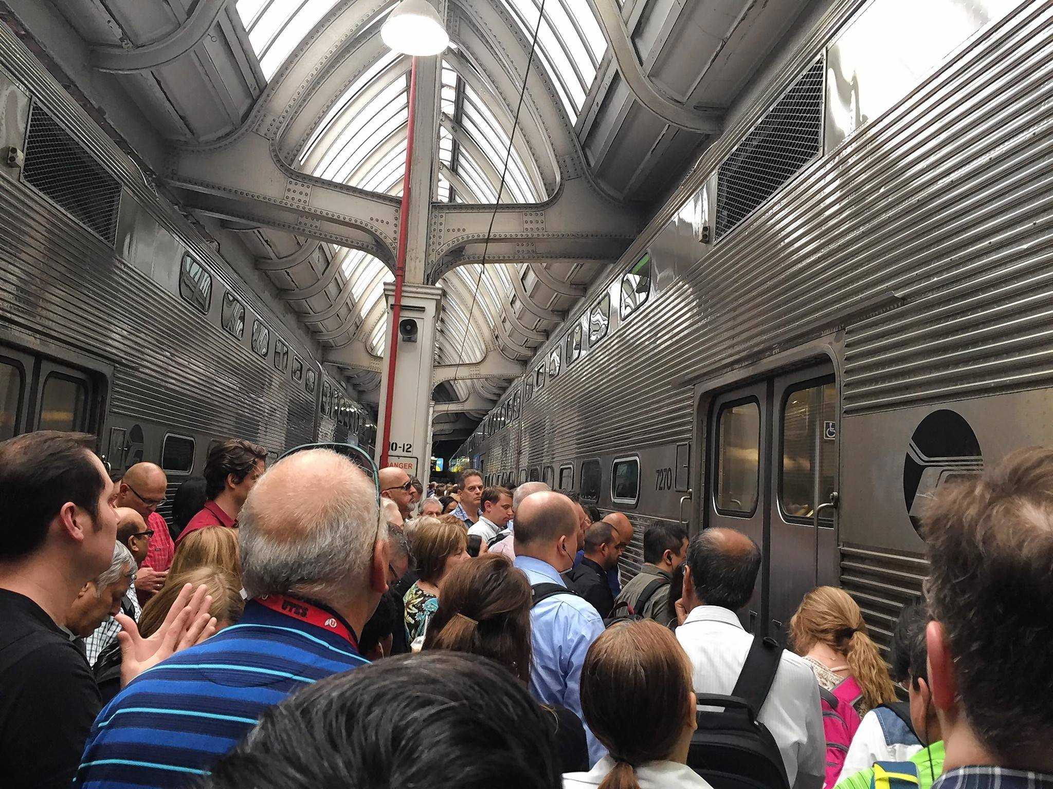 Metra BNSF passengers pack between trains at Union Station in Chicago to board last week.