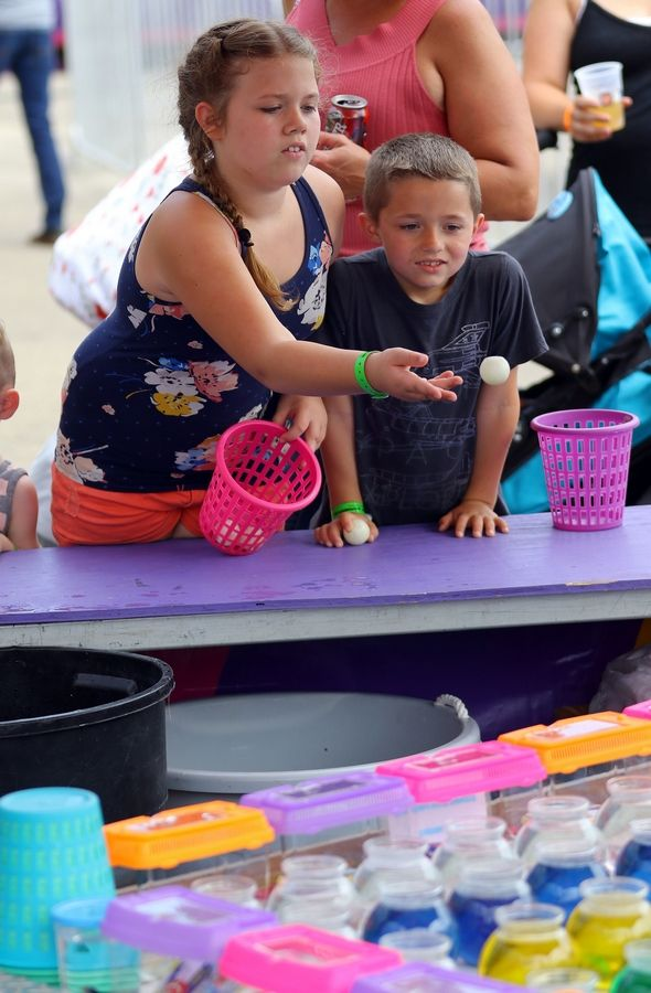 Cali Bremmer 10, and her brother Carter, 7, both of Wonder Lake try to win goldfish during Wauconda Fest in Cook Park Saturday.