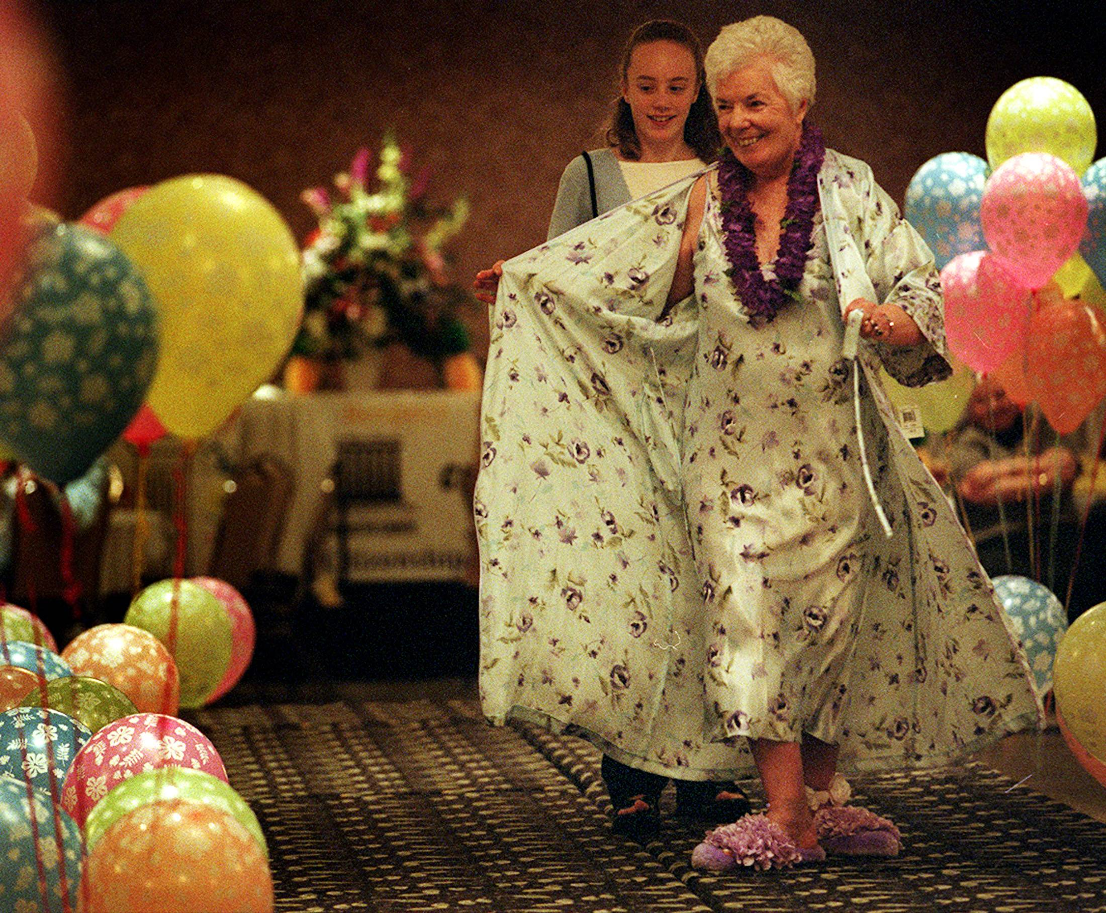Helen Muha, of Bartlett and St. Charles, models an outfit at a fashion show for charity along with her granddaughter, Sarah Anderson in 2002.