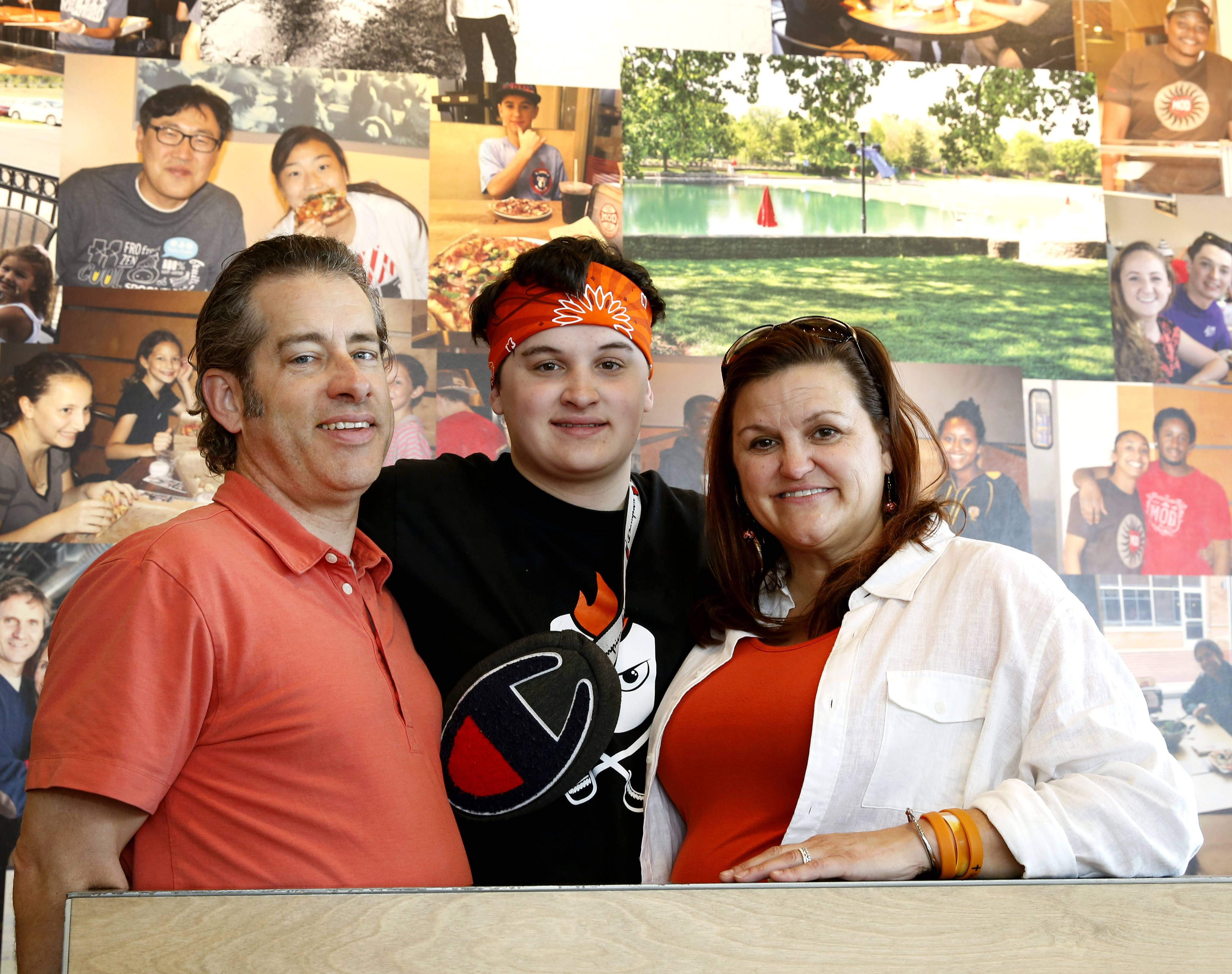 The Pedley family of Naperville includes Ken, Asher, Jennifer and the couple's younger son, Isaac, whose photo is on the wall directly above his brother's head inside the MOD Pizza restaurant in downtown Naperville. The Pedley family is allowing MOD to sell the Isaac pizza this summer to benefit a mental health charity in his memory.