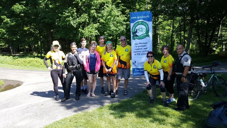 Friends of Cycling in Elk Grove join Cook County Forest Preserve Police and Conant High School student volunteers for the June 2018 Pit Stop at Busse Woods bike trail.